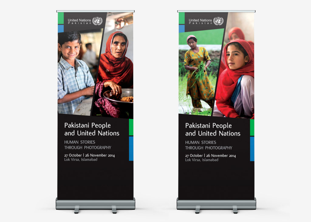 Pakistani people and United Nations exhibition roll up banners